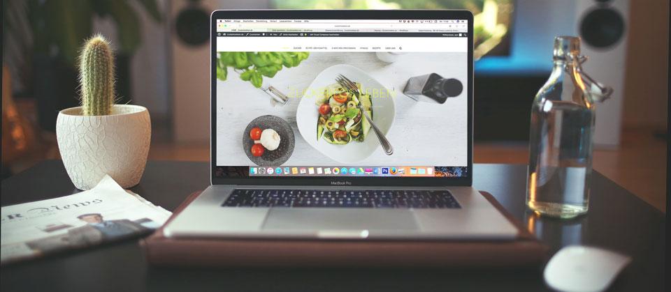 Open laptop with website